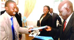 Mubiru (Right) and Dr. Maalanti exchange the MoU's