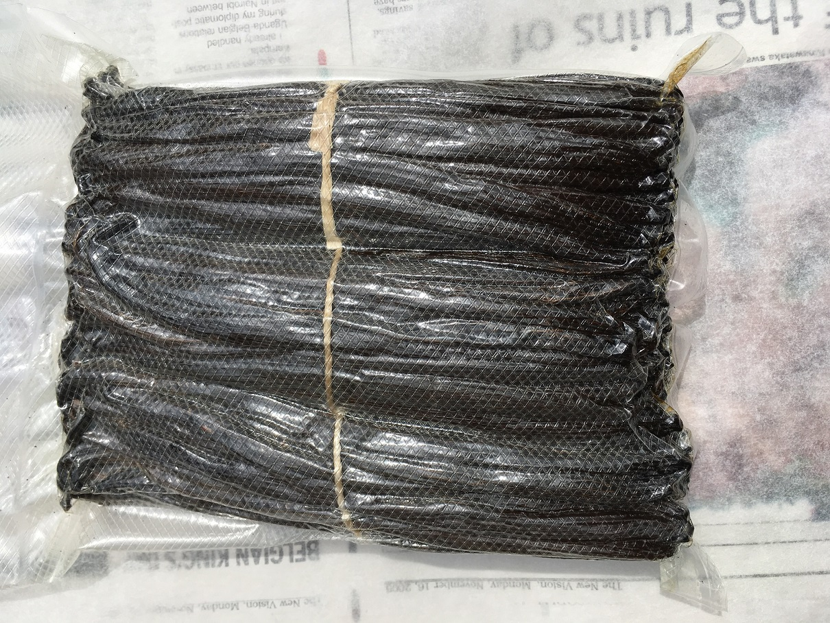 Vacuum Packed Vanilla Beans/Pods in Uganda just before export. These three bundles of Grade A Vanilla Beans weigh about 2/3rds of a Kilogram in total.