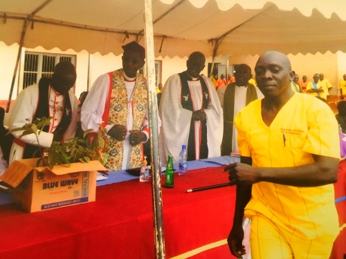 Jonathan Mugerwa after handing over seedlings to His Grace Bishop Stanley Ntagali of Church of Uganda ; Luzira Maximum Prisons 2016