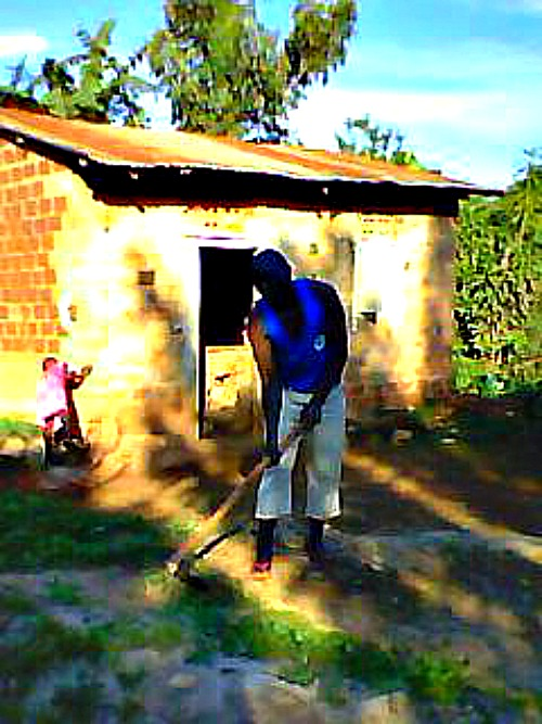 Clearing around my first home after prison, Buyongo Village Ndejje